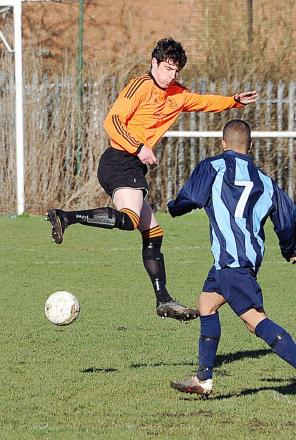 Craig Morris, left, in action for Oxenhope against Campion