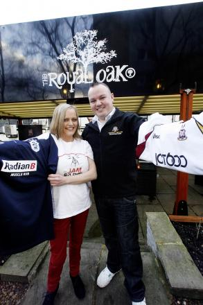 l Sharon Cooper, of Jam Radio, and Paddy Gaskin, assistant manager at the Royal Oak in Keighley, with two football shirts to be auctioned in aid of the family of tragic Riley Turner