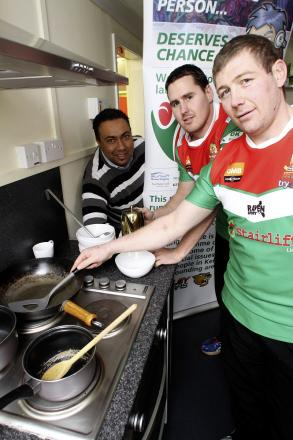 l Joining Ash Choudry, left, of Your Sporting Chance, is joined in the Progress Cafe kitchen by Keighley Cougars players Paul March, right, and Brendon Rawlins