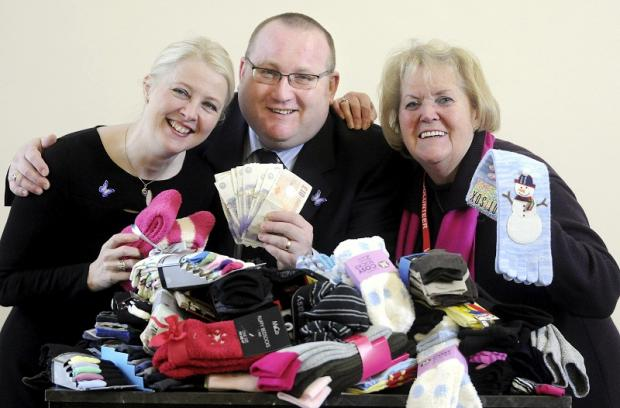 l With some of the socks donated to Airedale Hospital's Dignity Room are (from left) deputy director of nursing, Debra Fairley; Martin Barrow, master of Craven Masonic Lodge, and Friends of Airedale Hospital chairman, Eileen Proud