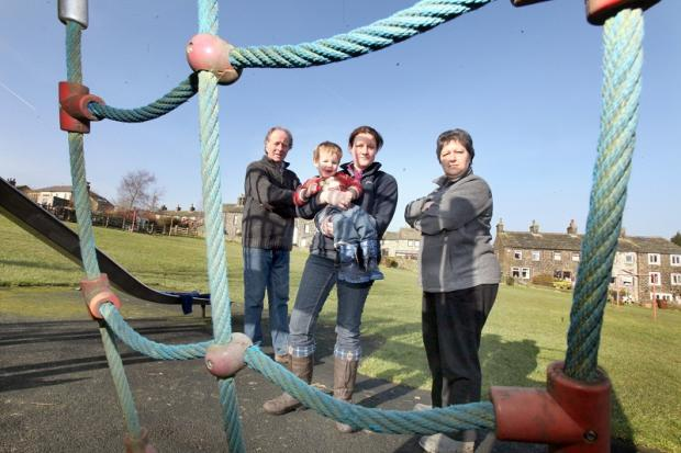 Martin Robson, Friends of Middleton and Ickornshaw chairman, Vicky Pearman, James Pearman and secretary Georgina Dunne at the play area they are hoping to revamp