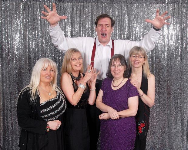 At the Yorkshire Cat Rescue ball are (front, from left Paula Godfree, Camilla Brown, Sara Atkinson and Jo Chafer with charity supporter and 'Jaws' James Bond villain lookalike Gary Tiplady         Picture by David Lowdell Photography