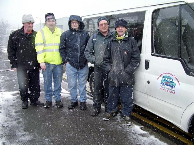 Keighley Community Transport driver, Peter Ormerond, left, with skill sharers from Keighley Shares' Branching Out next to the minibus available to participants in the project