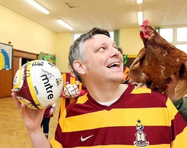 Headteacher Richard Hunt checks for fowl play from the Bantams 'winger'