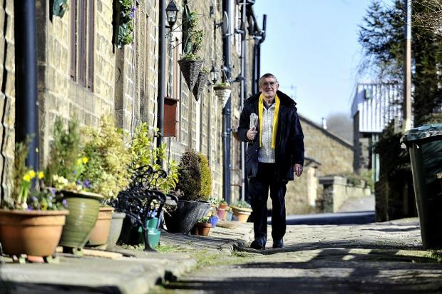 Councillor Tony Caunt walking down Club Row in Wilsden, the subject of another planning row
