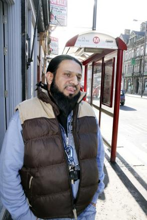 Shahid Rasool outside the North Street shop where he wants short-term parking to replace the existing bus stop