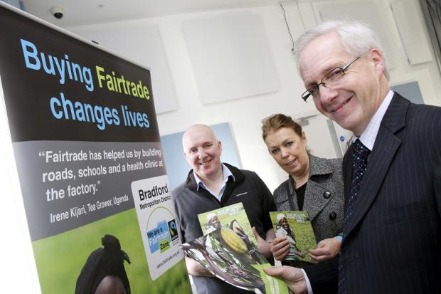 Keighley News: Town centre manager, Philip Smith, right, at the Fairtrade event in Keighley Civic Centre with Richard Dillon, an elected member of the West Yorkshire area committee of the Co-operative Group, and Linda Gomila, Co-operative membership officer