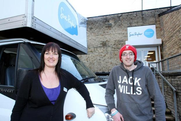 Manorlands shop manager, Jackie Burke, and driver, Scott Wright, with the charity's delivery van, which needs an overnight home