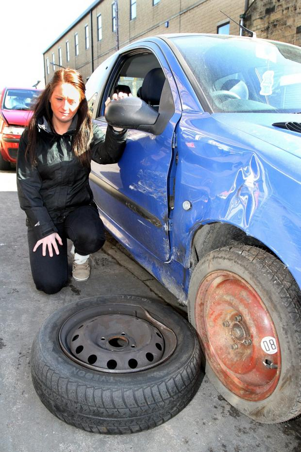 Angela Fish and her damaged car