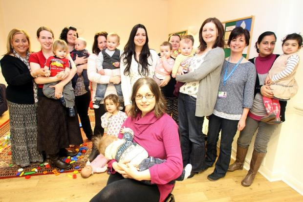 Claire Clayton-Stead, of Steeton, and her six-month-old son, Ben, with mums and children from the Breastfeeding Buddies group and staff at Keighley Healthy Living