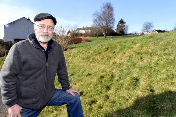 Alec Brown outside the Sue Belcher Centre in Bracken Bank where the new wildflower meadow will be planted