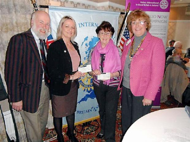 Maurice Baren at the cheque presentation with, from left, Gill Smith from Action for Children, Mary Parker from Yorkshire Cancer Research and Keighley Rotary Club president Liz Joyce
