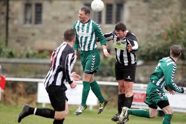 Chris Simnpson wins a header for Steeton last weekend against Marsden. On saturday, the Chevrons are bidding for a Keighley & District FA Cup final berth