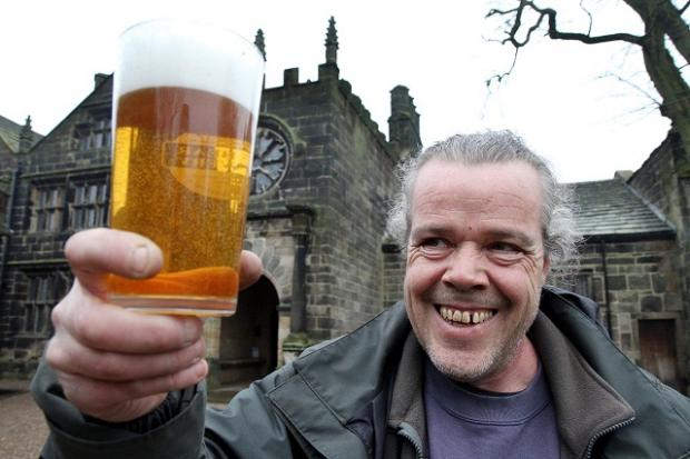 East Riddlesden Hall groundsman Nick Chuck checks the quality of the ale ahead of the venue's beer festival