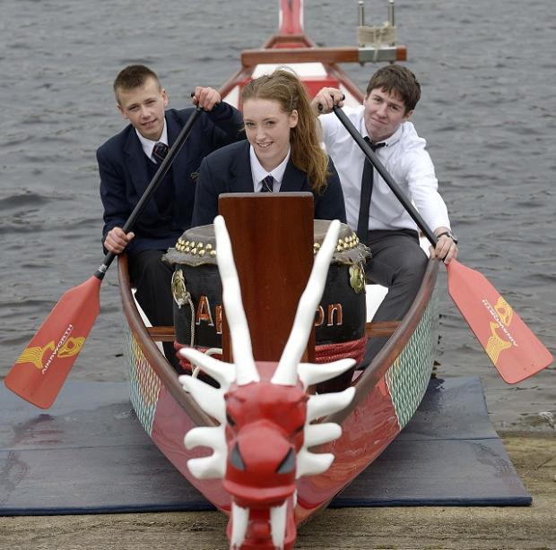 Appleton Academy students Damien Hields, Lucy Wilby and Rhys Kittsen with a new Dragon Boat they secured funding for at Doe Park in Denholme