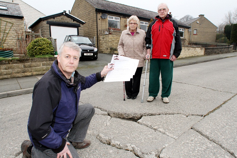Local councillor Andrew Mallinson with residents of Spencer Avenue by one of t