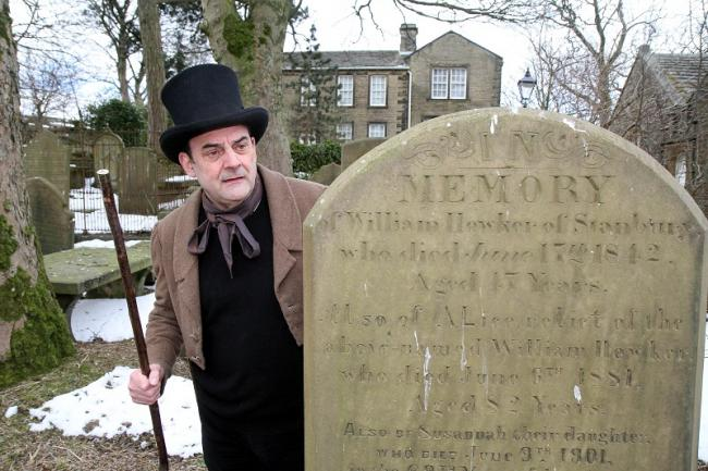 David Broadley plays the part of Benjamin Babbage in Haworth churchyard for the history walks