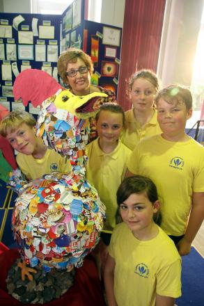 Haworth Primary School headteacher, Janet Parkinson, joins pupils, from left, Liam Morrissey, Minnie Blackstone, Macie Karpuz, George Jacques and Charlotte Connides-Smith with their cockerel sculpture