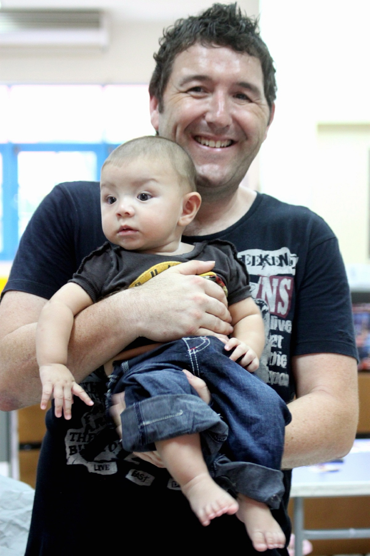 Adam Pickles, from Keighley, pictured with his son, Benjamin, before the attack in Thailand that left him in a coma