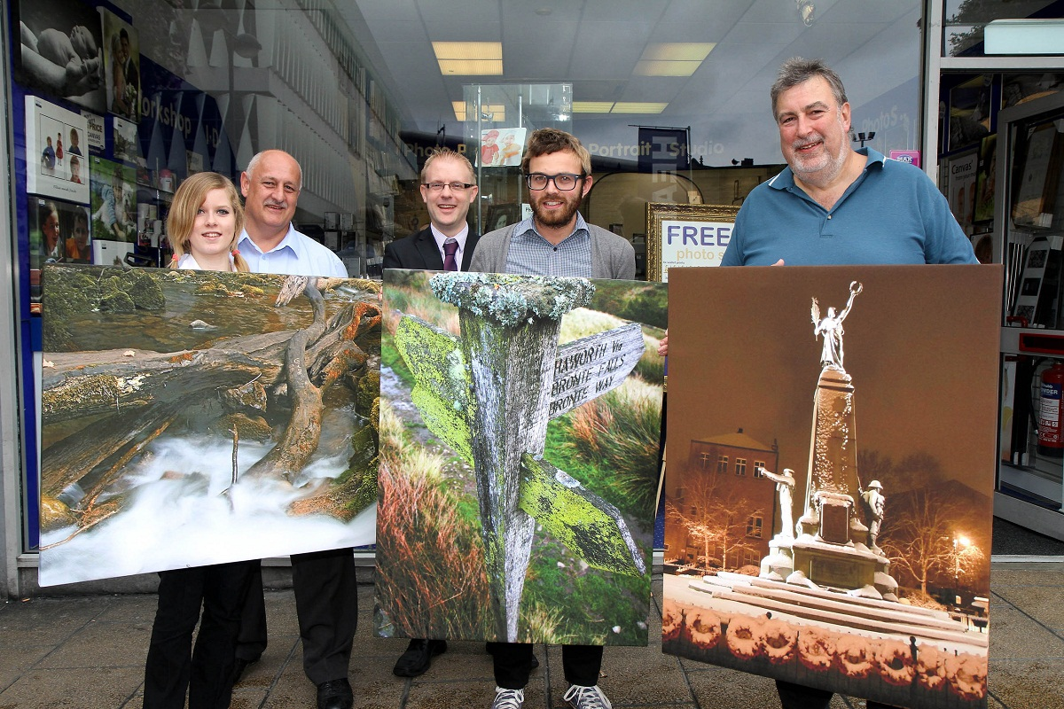 Competition winner Joe White, centre, and runner-up David Smith, right, show off their canvas print prizes with, from left, Sophie McDavitt of Max Spielmann, Airedale Shopping Centre manager Steve Seymour and Keighley News editor, Richard Parker