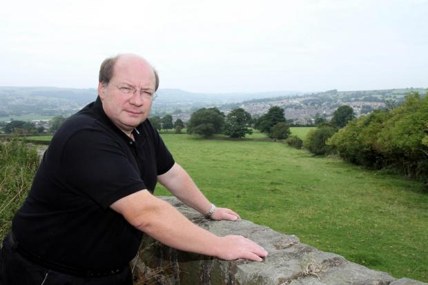 Councillor Adrian Naylor overlooks fields on the edge of Silsden he says may be earmarked for housing