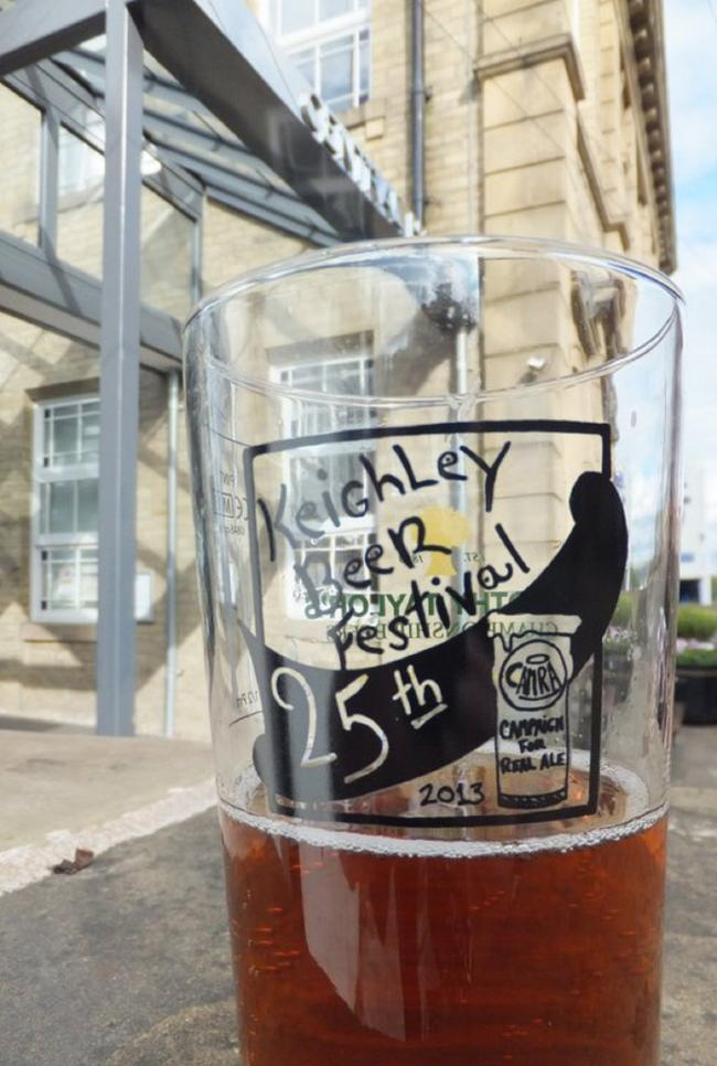 This year's beer festival souvenir glass, sponsored by Timothy Taylor's brewery