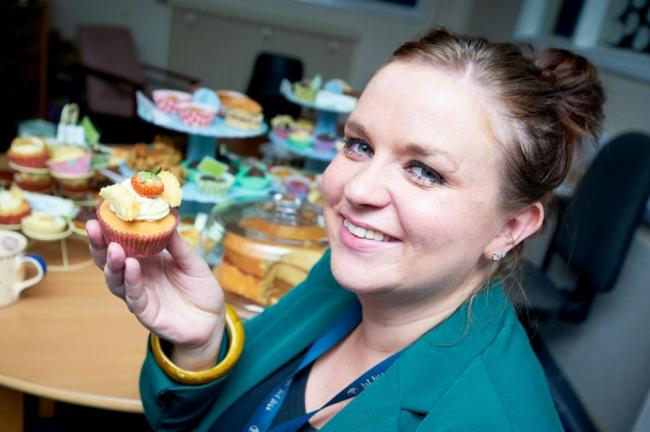 Airedale NHS Foundation Trust human resources advisor, Jodie Hearnshaw, enjoying some of the tasty treats at the cake sale