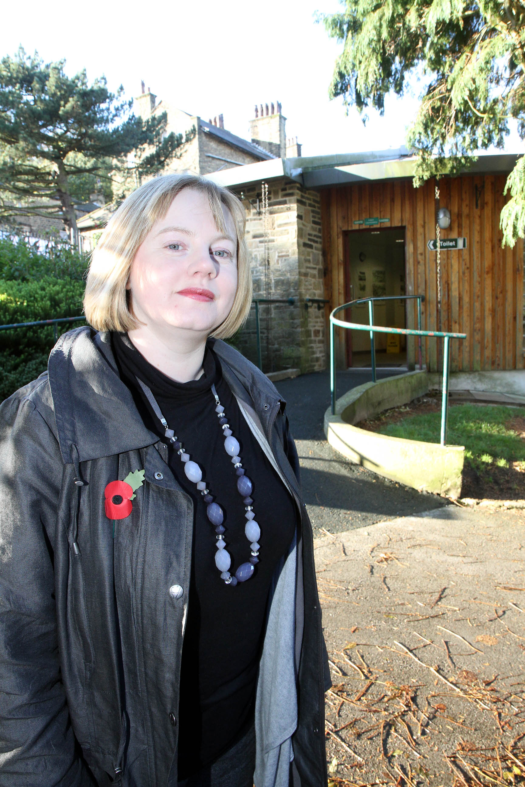 Councillor Rebecca Poulsen outside the toilets in Central Park, Haworth,