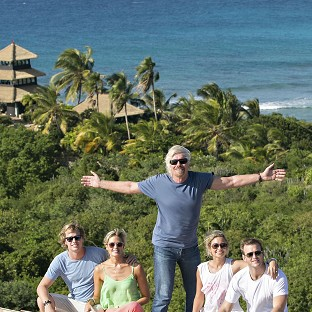 Sam Branson, Isabella Calthorpe, Richard Branson, Holly Branson and Freddie Andrews pose before their new island home