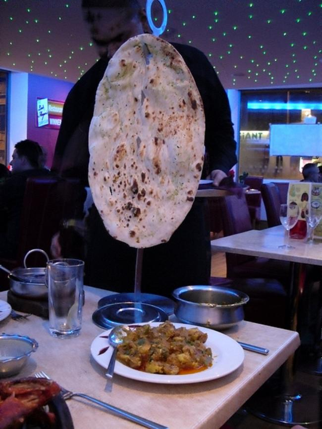 Serving up one of the giant naan breads at the Shimla Spice restaurant in Keighley