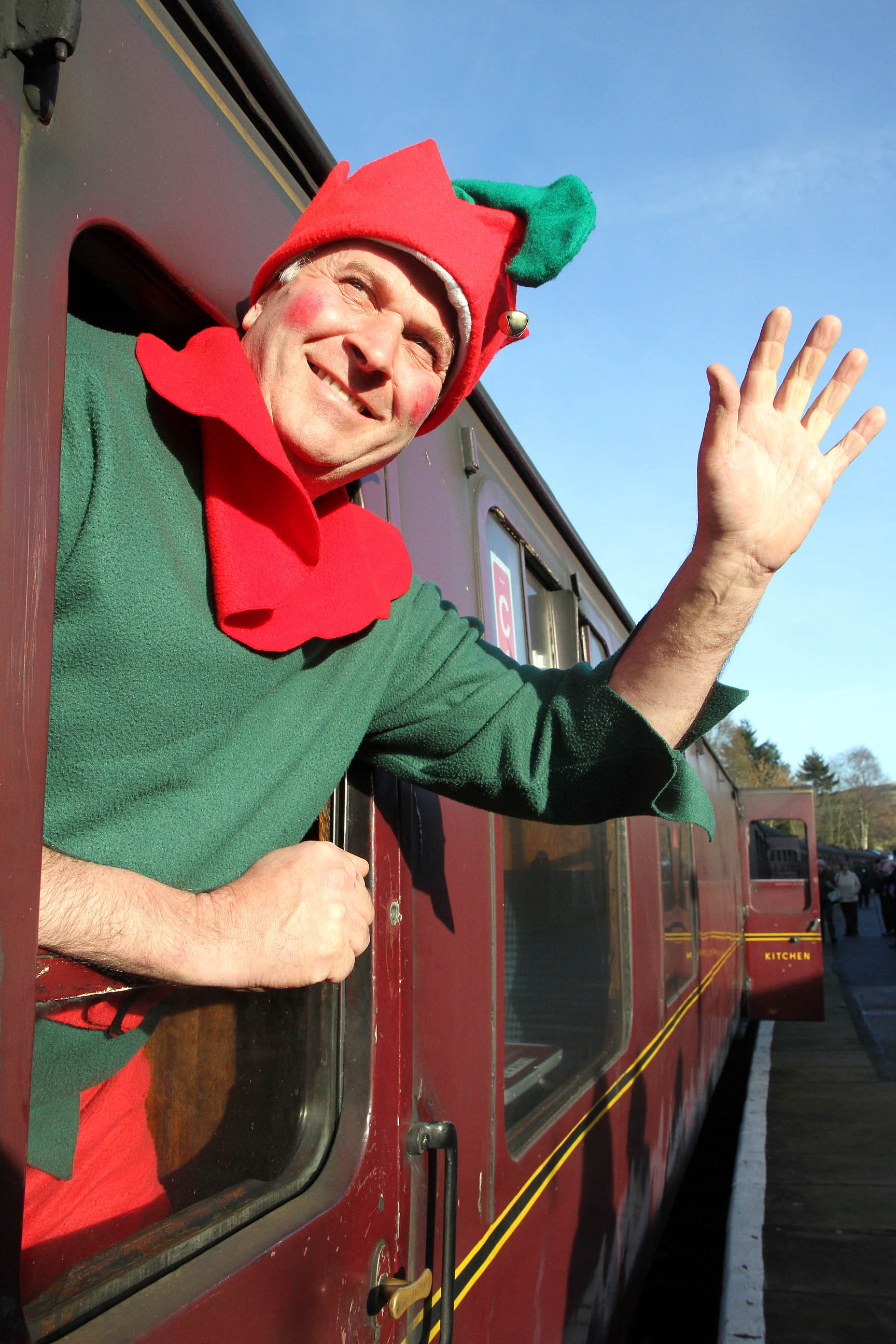 Santa's helper, Richard Lamb, waves to the crowds of visitors at Oxenhope Station for the Santa Special service