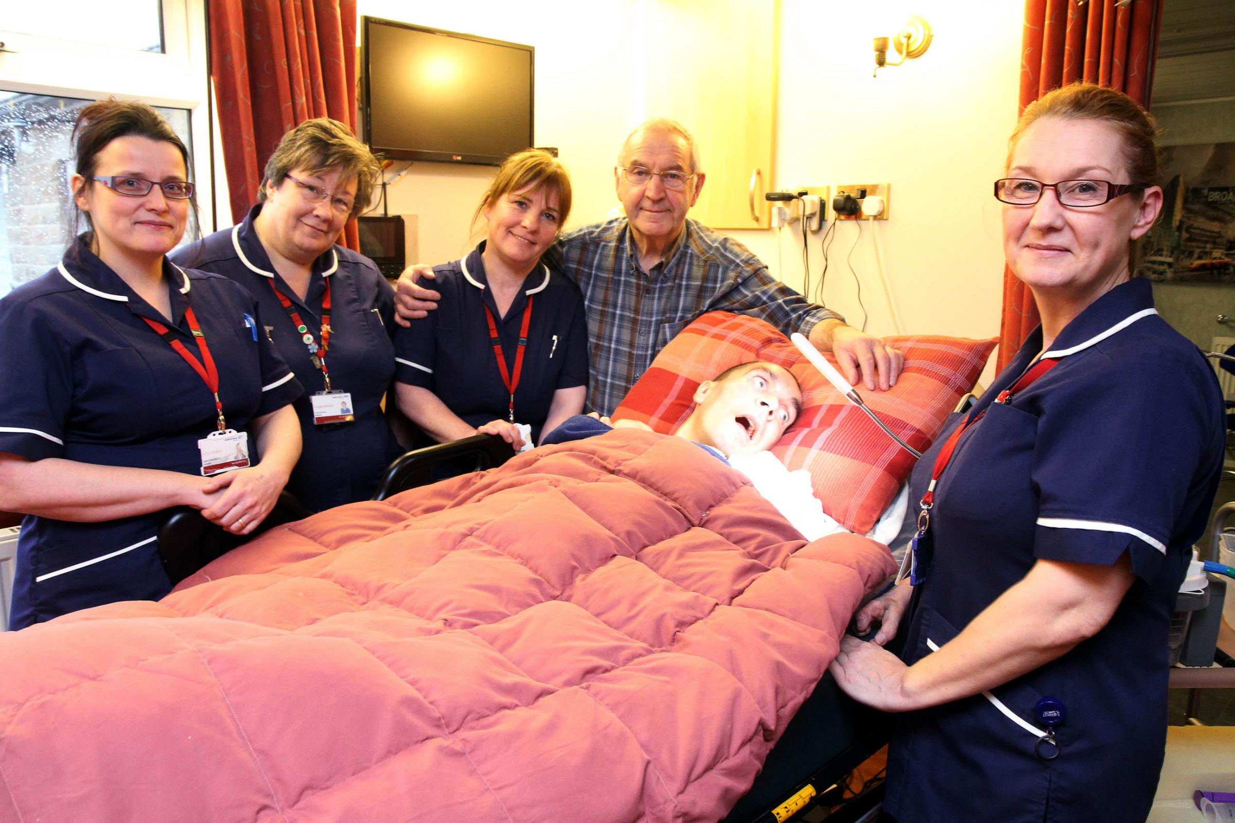 TRIBUTE: Stewart Whitaker pictured with his father John and his care team