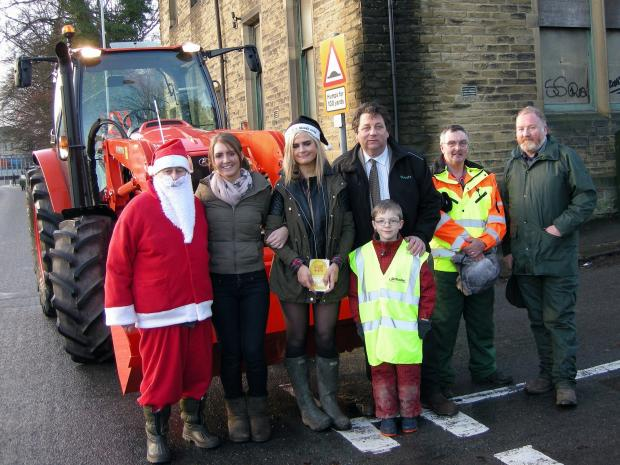 Keighley News: 'Santa' Stanley Turner with some of those who took part in the Bronte Christmas Tractor Run