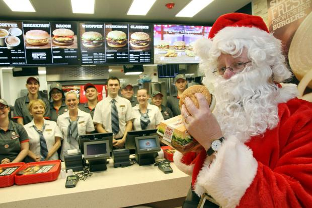 Santa tucks in to a Whopper after opening the new Burger King outlet in Keighley's Airedale Shopping Centre