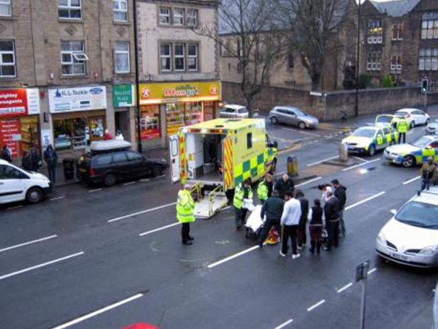 A 12-year-old boy injured in a collision with a car in Keighley town centre is treated at the scene by paramedics