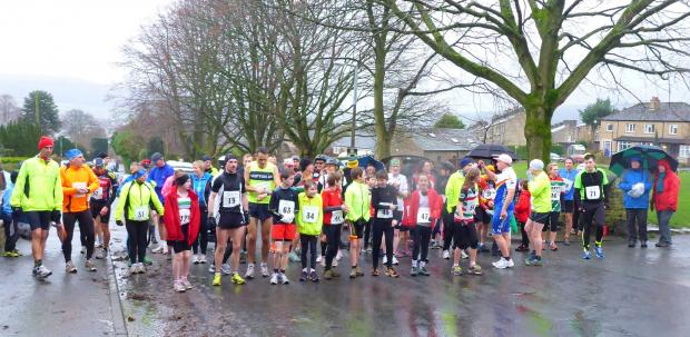 Competitors get ready to brave the conditions at the start of the Silsden Fun Run