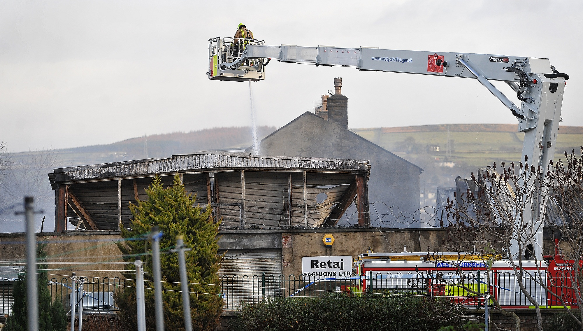 Firefighters douse down the scene of devastation after fire rips through a former snooker hall for the second time in less than a week, completely gutting the building