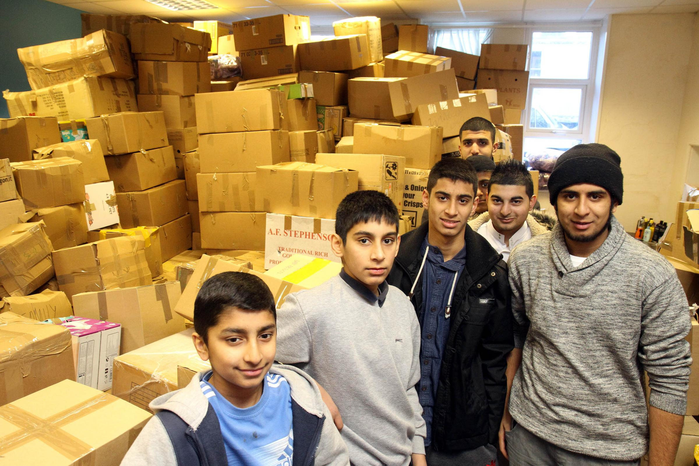 Volunteers at Keighley's al-Hikmah Centre with parcels for Syria