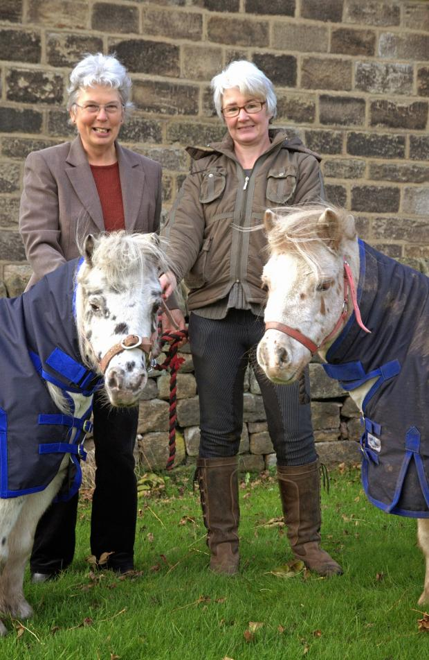 Keighley News: Karen Leaver, from the Craven Trust, and Susan Dunne, from Pat A Pony, with Alfie and Spot