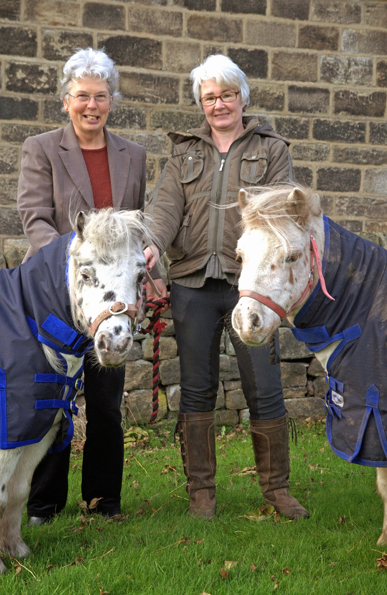 Karen Leaver, from the Craven Trust, and Susan Dunne, from Pat A Pony, with Alfie and Spot
