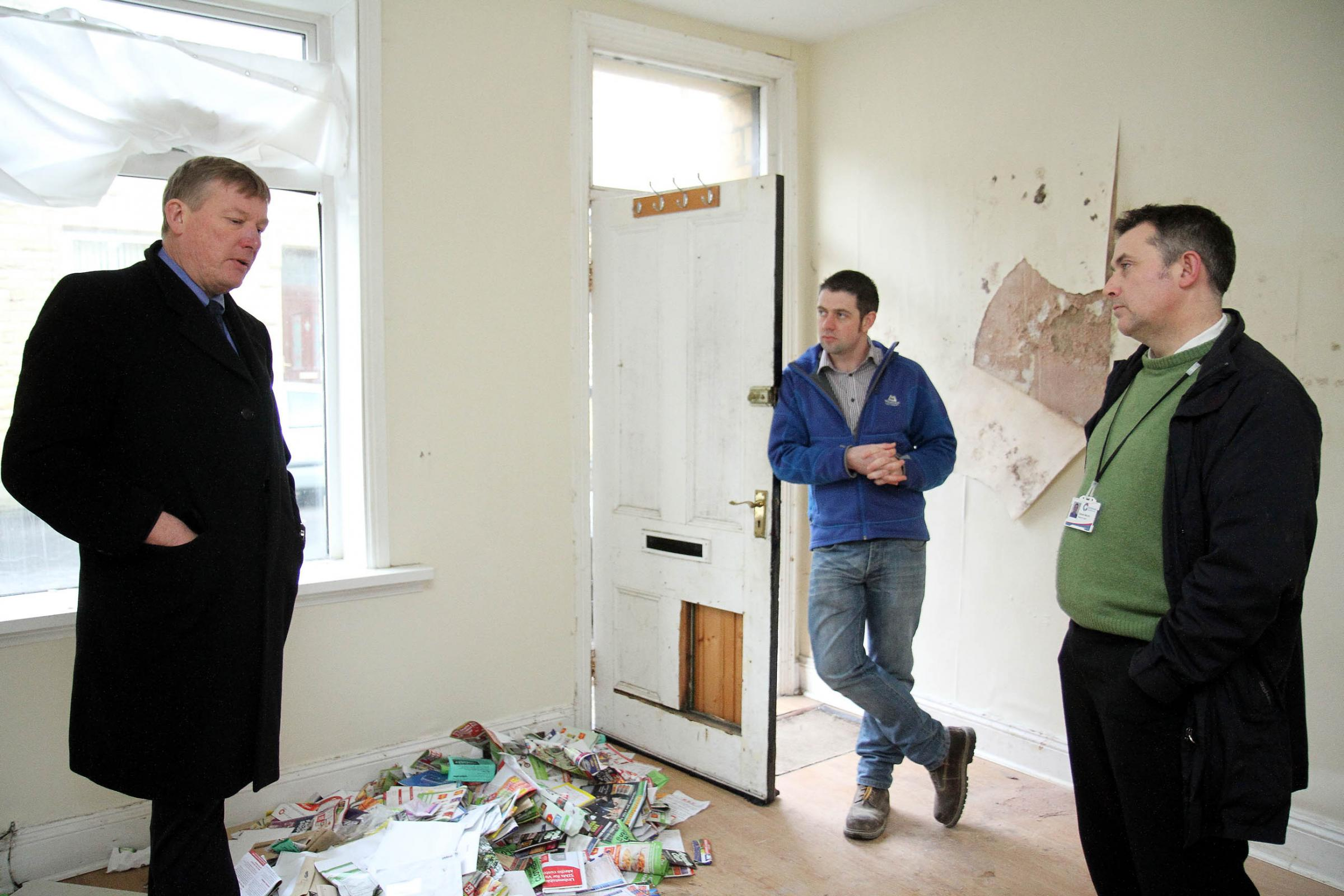 Housing minister Kris Hopkins talks to Dave Gibson, Keyhouse's empty homes worker and the project's head, Graham Mynott
