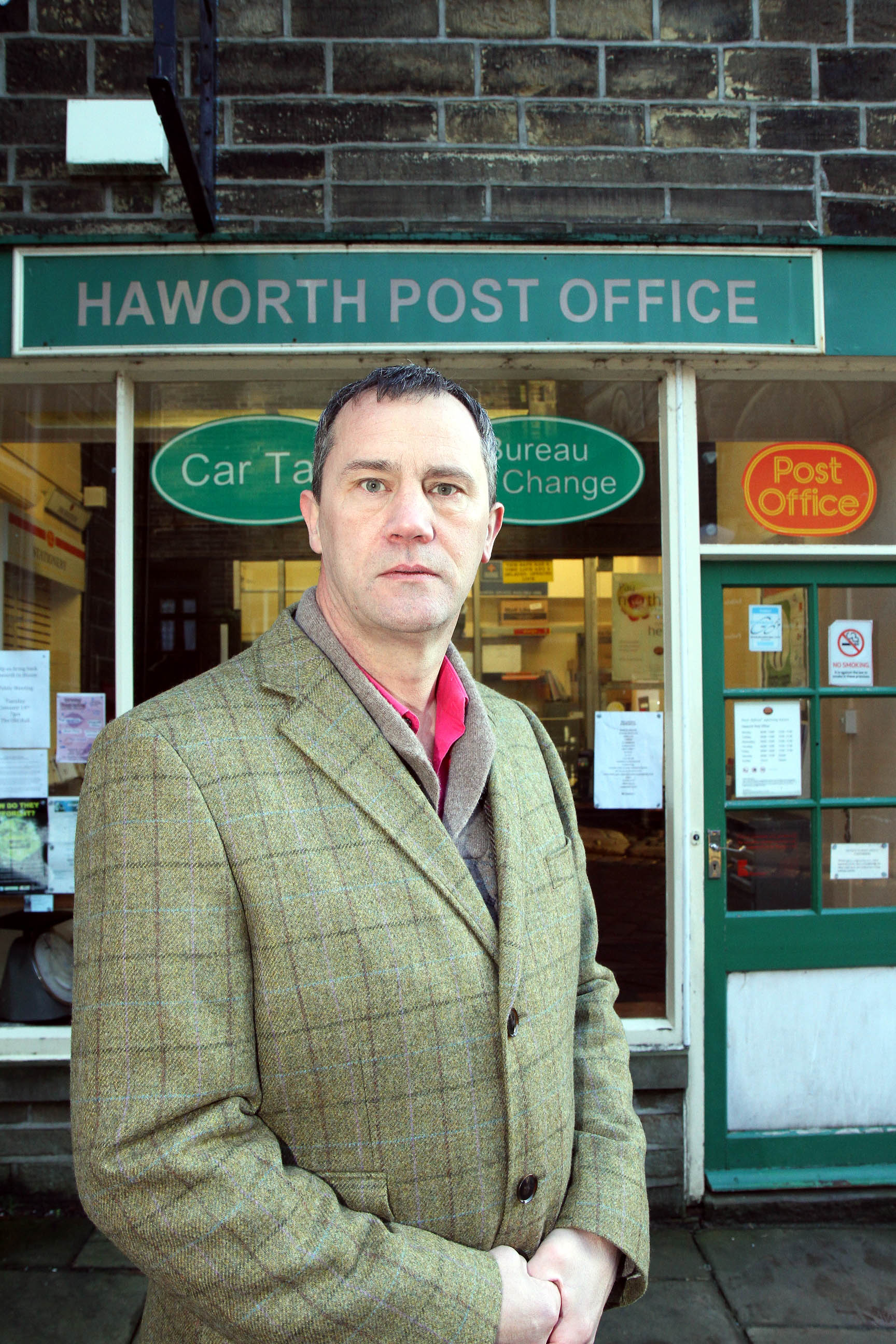 Councillor Glen Miller outside Haworth Post Office