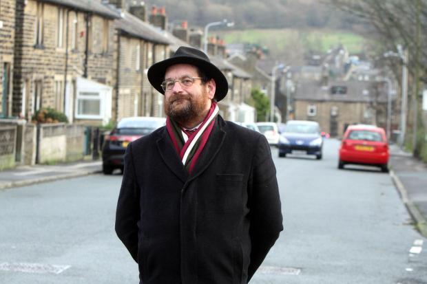 Councillor Keith Dredge stands on Grafton Road, Keighley, where residents have been complaining of increased traffic after traffic humps were installed nearby