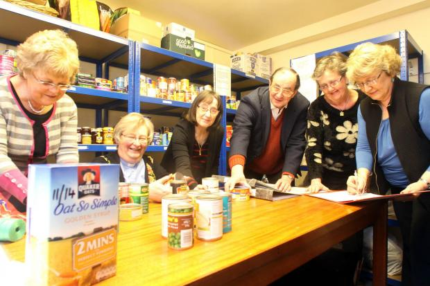 Helpers at the Bingley food bank prepare items for distribution to the needy