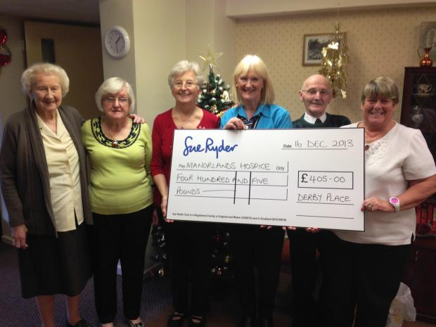 Residents at Derby Place housing scheme with their cheque