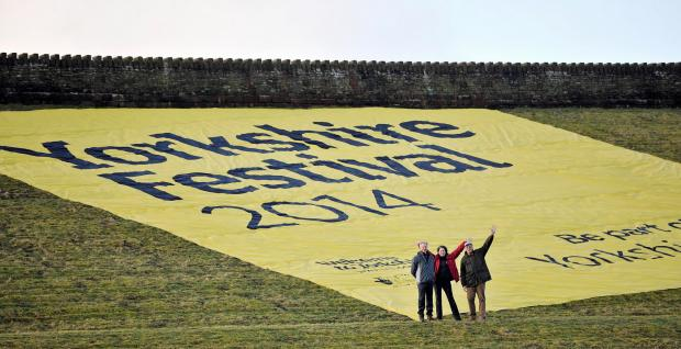 Richard Flint (chief executive of Yorkshire Water), Henrietta Duckworth (festival executive director) and David Lascelles (chairman of the festival steering group) with the banner
