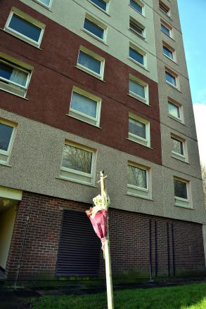 A floral tribute outside the flats