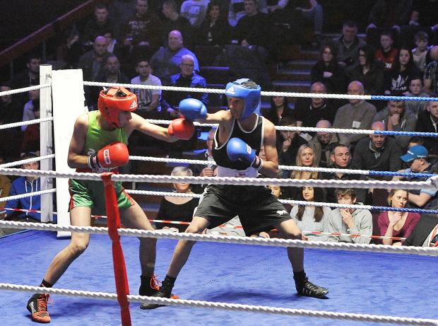 Keighley News: Keighley's Awais Muhammad, left, takes on Aseel Ahmed at Victoria Hall