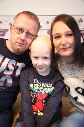 Cancer patient Callum Ingham, eight, with his mum, Kim Ager, and dad, Matthew Ingham