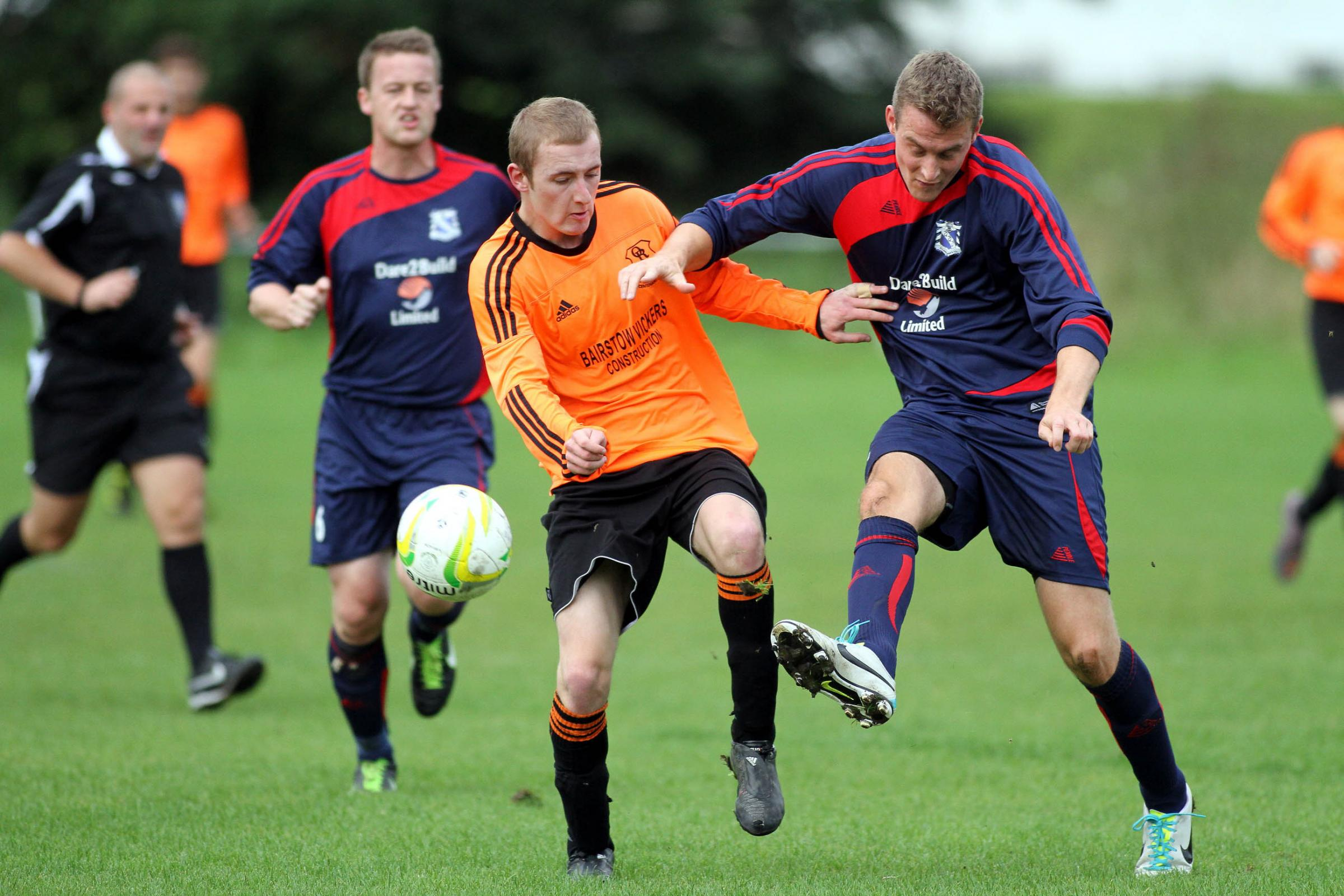 Oxenhope's star man Tom Marshall, centre, scored four along with Dan Moriarty